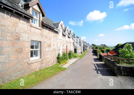 Isle of Iona, Scotland - 8th June 2014 : Beautiful view of some houses on the Isle of Iona in Scotland. A famous touristic spot where the Iona Abbey i - Stock Photo