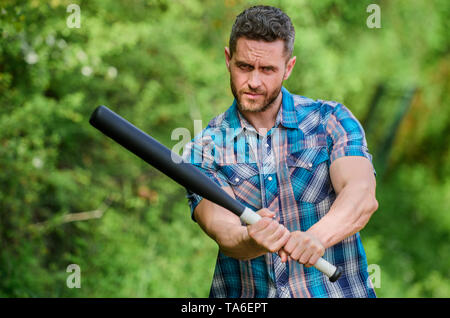 man with baseball bat. i am a criminal. outdoor sport activity. Hooligan man hits the bat. Bandit gang and conflict. aggression and anger. full of energy. unshaven muscular man fighting. Sport. - Stock Photo