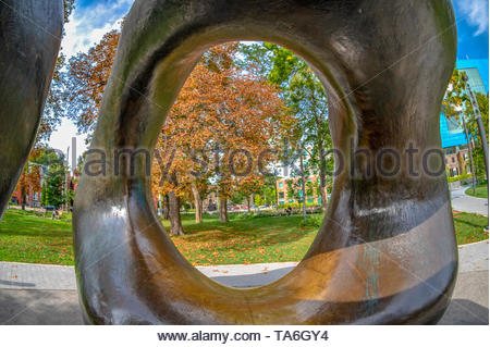 Toronto, Ontario, Canada-May 6, 2019:   'Large Two Forms' an art piece by Henry Moore in the Grange Park. The piece is one of the most known symbols o - Stock Photo