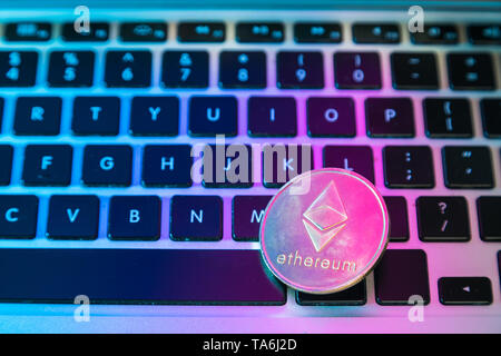Circle Ethereum coin on top of computer keyboard buttons. Digital currency, block chain market, online business - Stock Photo