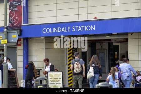 London, United Kingdom, June 14 2018. The entrance to the Colindale underground station, on the outskirts of London. White lettering on a blue backgro - Stock Photo