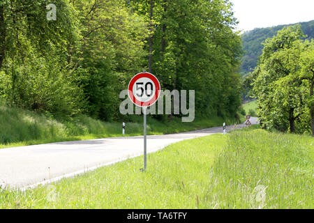 Various road signs on the road warn of danger. - Stock Photo