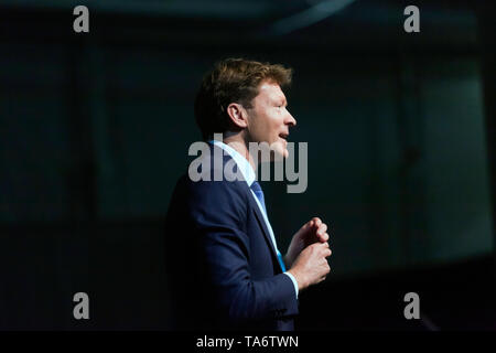 Richard Tice, Chairman of The Brexit Party, introducing the speakers, during a Political Rally held at Olympia London - Stock Photo