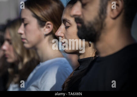 World Meditation Day performed at the top of The Gherkin building led by meditation guru Will Williams. London, UK. - Stock Photo