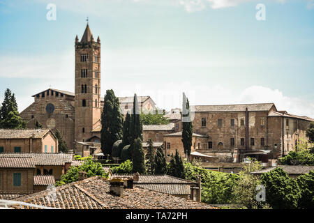 Siena skyline with the  campanile tower of the Basilica of  San Clemente in Santa Maria dei Servi, a   Romanesque style, Roman Catholic church in the  - Stock Photo