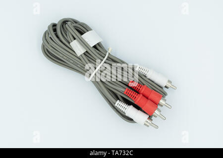 This is a capture for a red and white RCA cable on a white background and a studio light - Stock Photo