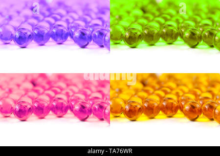 set of colored spherical ball capsules of fish oil selective focus isolated on white background. - Stock Photo