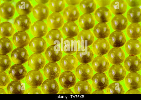ufo green spherical ball capsules selective focus weird abstract background. - Stock Photo