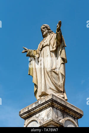 Statue of Sacred Heart of Jesus opposite the Se Cathedral, Old Goa, India - Stock Photo