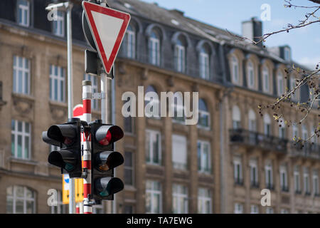 Forbid traffic lights. Road sign give way. Road signs. Traffic light on a city street. Traffic control vehicles. Traffic Laws. - Stock Photo