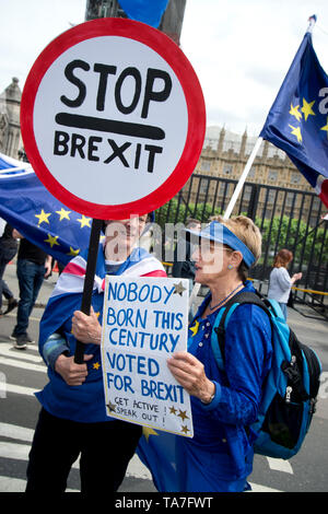 Westminster. Opposite Houses of Parliament May 22nd 2019. Protest to stop Brexit by Remainers. One woman holds a sign saying 'Stop Brexit' and another - Stock Photo