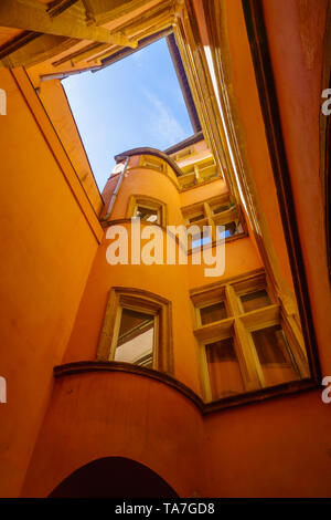 Lyon, France - May 10, 2019: Building above a Traboule passage, in Old Lyon, France - Stock Photo