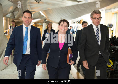 Edinburgh, UK. 22 May 2019.  PICTURED: (left-right) Maurice Golden MSP; Ruth Davidson MSP; Adam Tomkins MSP.  The end of First Ministers Questions session at the Scottish Parliament in Holyrood in Edinburgh. After the chamber has emptied, MSP's are seen in the Garden Lobby going to various meetings.  The First Minister's Questions are usually held on a Thursday, however due to the European Parliamentary Elections happening tomorrow, (Thursday 23rd May) the session has been conducted a day early. - Stock Photo