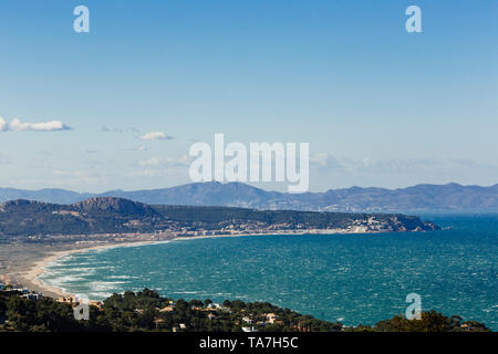 Sunset view from Begur to the bay of El Mas Pinell - Stock Photo