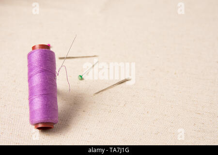needle and thread closeup image with asssorted pins and copy space for text. - Stock Photo