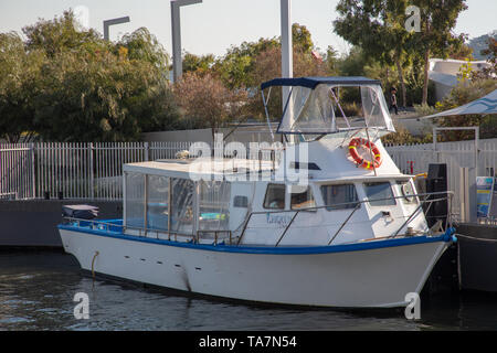 Small fishing boat moored in the harbour of Swan River, Perth, Western Australia. - Stock Photo