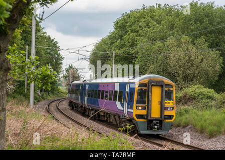 Class 158 diesel multiple unit train. Seen at Golborne junction on the West Coast Main Line. - Stock Photo