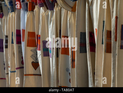 Senufo textiles and clothing at street market, Savanes district, Waraniene, Ivory Coast - Stock Photo