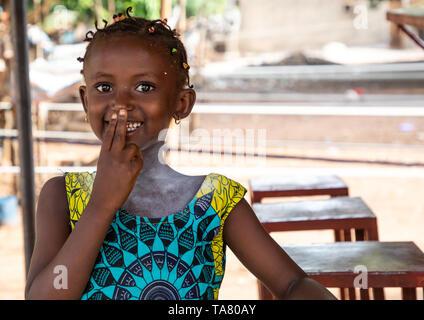 Portrait of a shy african girl, Savanes district, Waraniene, Ivory Coast - Stock Photo
