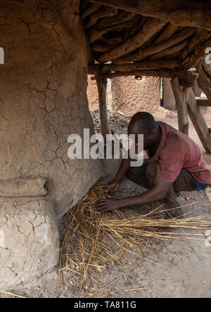 Senufo blacksmith preparing the fire, Poro region, Koni, Ivory Coast - Stock Photo