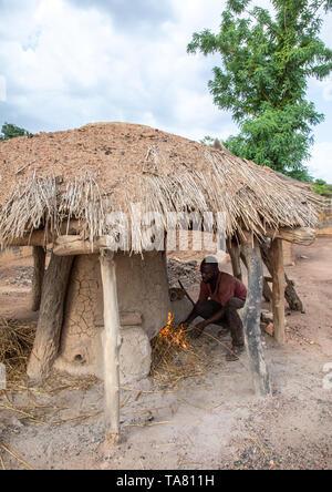 Senufo blacksmith preparing the fire, Poro region, Koni, Ivory Coast - Stock Photo