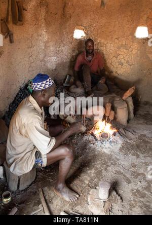 Senufo blacksmith working in his workshop, Poro region, Koni, Ivory Coast - Stock Photo