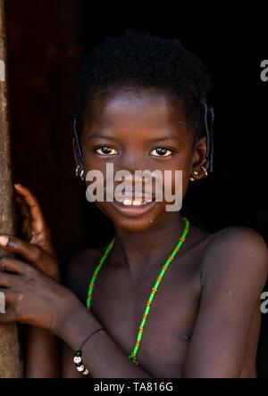 Portrait of a smiling Senufo girl, Savanes district, Niofoin, Ivory Coast - Stock Photo