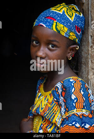 Portrait of a Peul tribe girl with colorful clothes, Savanes district, Boundiali, Ivory Coast - Stock Photo