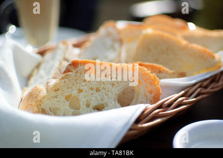Toast bread in the basket on the table in caffe. Breakfast concept - Stock Photo