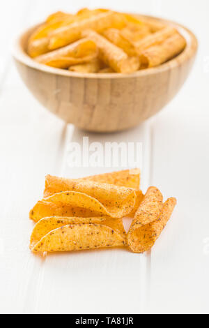 Rolled tortilla chips on white table. - Stock Photo