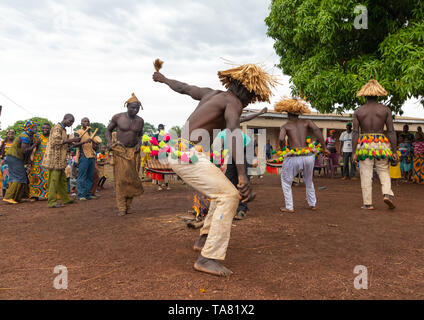 Senufo shirtless man dancing the Ngoro during a ceremony, Savanes district, Ndara, Ivory Coast - Stock Photo