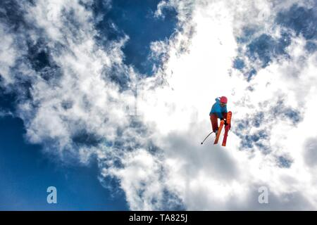 skier jumping on a snow park in Austrian alps - Stock Photo