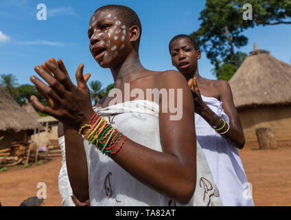 Dan tribe young women clapping hands and dancing during a ceremony, Bafing, Gboni, Ivory Coast - Stock Photo