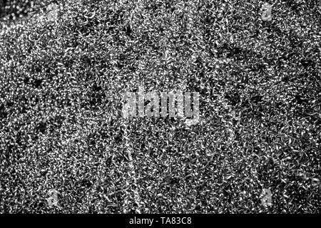 Metal shavings. Pile of metal sawdust from cnc machining. - Stock Photo