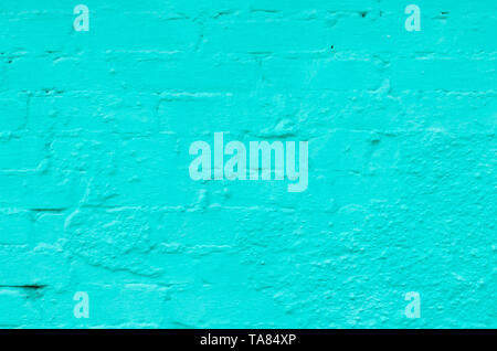 Background of brick wall painted in turquoise. - Stock Photo