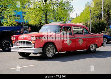 Salo, Finland. May 18, 2019. Red Checker Model A Taxi takes part in Salon Maisema Cruising 2019. - Stock Photo