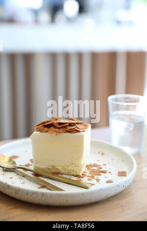 Japanese cheesecake on wooden table - Stock Photo