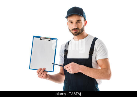 serious delivery man pointing with pen at clipboard with empty paper and looking at camera isolated on white - Stock Photo