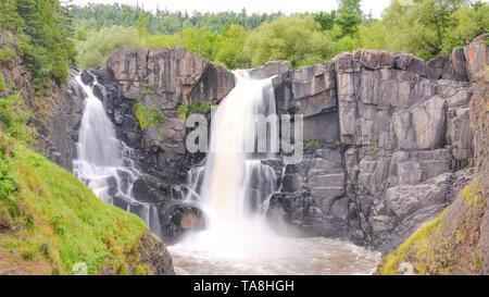 High Falls at US/Canadian border at Grand Portage State Park Minnesota - Stock Photo