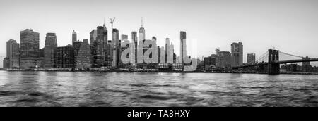 Black and white panoramic view of New York City silhouette at sunset, USA. - Stock Photo