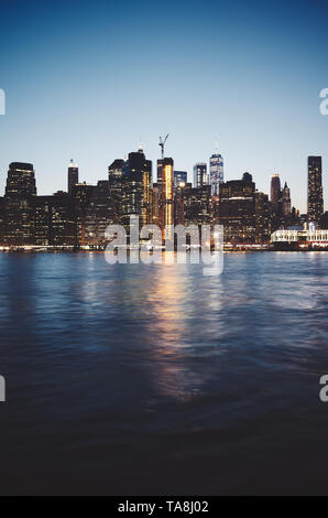 New York City at dusk, color toned picture, USA. - Stock Photo