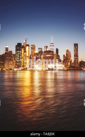Manhattan seen from the Brooklyn at dusk, color toned picture, New York City, USA. - Stock Photo