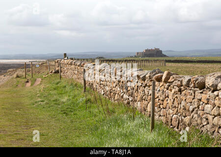 Lindisfarne Castle, built on Beblowe Crag, on Lindisfarne in Northumberland, England. Lindisfarne is also referred to as Holy Island. - Stock Photo