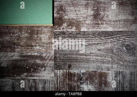 Laying laminate flooring. Laminate and substrate green. - Stock Photo