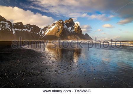 Sunset at Vestrahorn Mountain and Stokksnes beach. Iceland - Stock Photo
