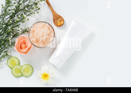 skin care concept. flat lays of skincare remedies style in white squeeze tube package with blank label and salt spa in glass bowl with natural materia - Stock Photo