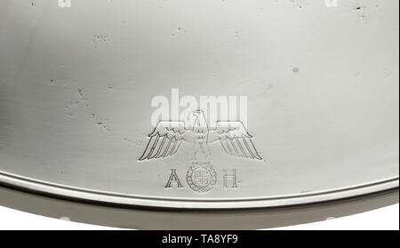 Adolf Hitler - a serving tray from his personal silverware in the New Reich Chancellery Tray made of non-magnetic 'Silwello' alloy by the manufacturer 'AWS' (August Wellner & Söhne), marked on the inside of the rim, hard silver-plated (renewed?) issue. Also engraved with national eagle and initials 'A.H.'. Diameter 36 cm, height 4 cm. Slight traces of age and usage. The firm Wellner manufactured among other things the cutlery for the Reich chancelleries, ministries and officers' messes. historic, historical, 20th century, 1930s, NS, National Socialism, Nazism, Third Reich, , Editorial-Use-Only - Stock Photo