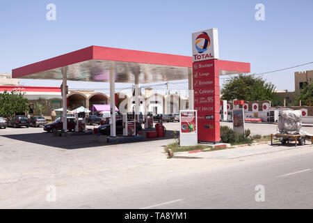 TUNISIA, AFRICA-CIRCA MAY, 2012: Red colored petrol station of Total company with Effimax gasoline. Effimax is the new generation of advanced fuel cre - Stock Photo