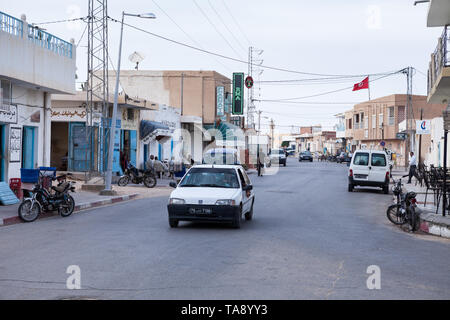 SOUSSE, TUNISIA, AFRICA-CIRCA MAY, 2012: Road traffic is on provincial town. Backstreets of Tunisian city with everyday life - Stock Photo