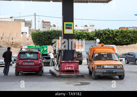 TUNISIA, AFRICA-CIRCA MAY, 2012: Drivers refuel cars on petrol station of Total company with gasoline. Total is a French multinational integrated oil  - Stock Photo
